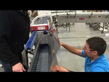 Upender Conveyor Solves Carton Orientation prior to Case Packer