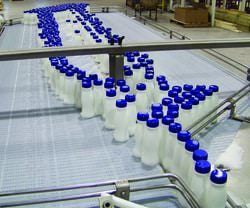 milk jugs on a conveyor